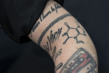 Sara showing her tattoo with the molecular composition of Chocolate