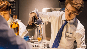 bartender-guy-pouring-cocktail